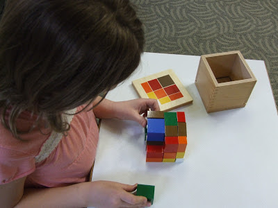 NAMC preparing montessori students for standardized testing girl with montessori math cube
