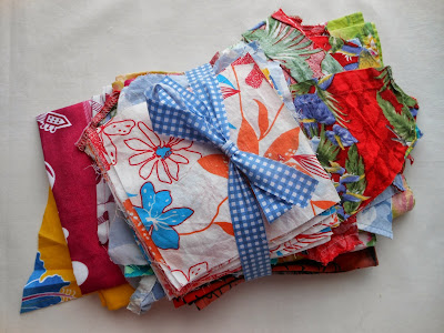hawaiian fabrics bundled together and tied with a bow