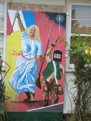 「市民を誘導する自由の女神」:  <br>我が玄関前の壁画