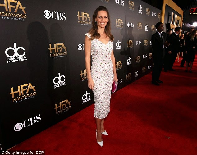 Hilary Swank looked lovely showing off her slender figure in a fitted dress with a floral design at the Hollywood Film Awards at the Palladium in Los Angeles