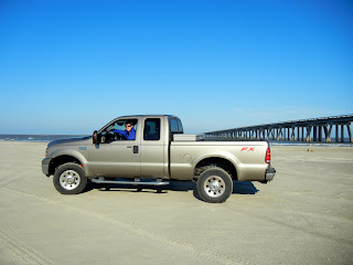 Our truck, on the beach in Galveston, TX