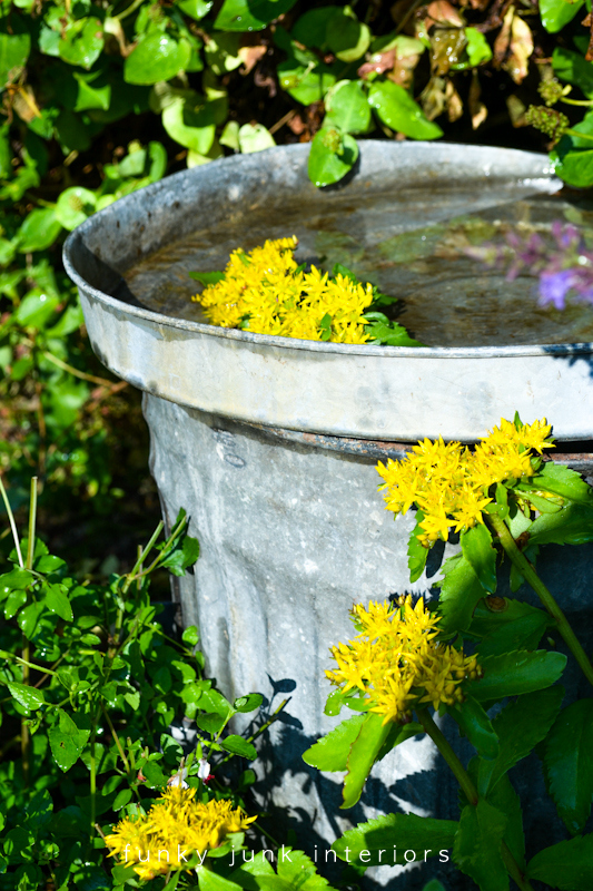 Garbage can birdbath for the garden via Funky Junk Interiors
