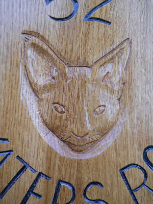 cat portrait carved in wood