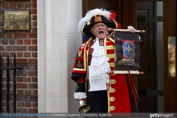Unofficial Town Crier Tony Appleton announces The Duchess of Cambridge has given birth to a girl outside St. Mary's Hospital in London, England on May 2, 2015.