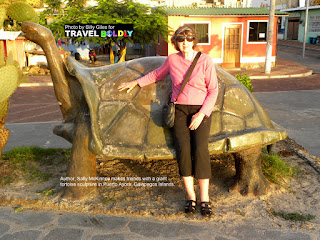 Travel Boldly Galapagos Island - During a walk to dinner at La Playa, in Puerto Ayora, Sally makes friends with a giant tortoise sculpture.