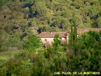 La masia de Can Pujol de la Muntanya des de la Costa de Can Térmens