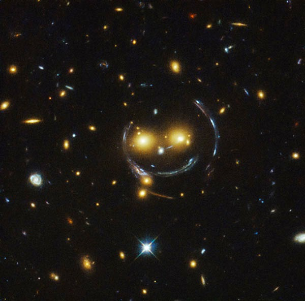 Hubble telescope discovers giant smile in space.