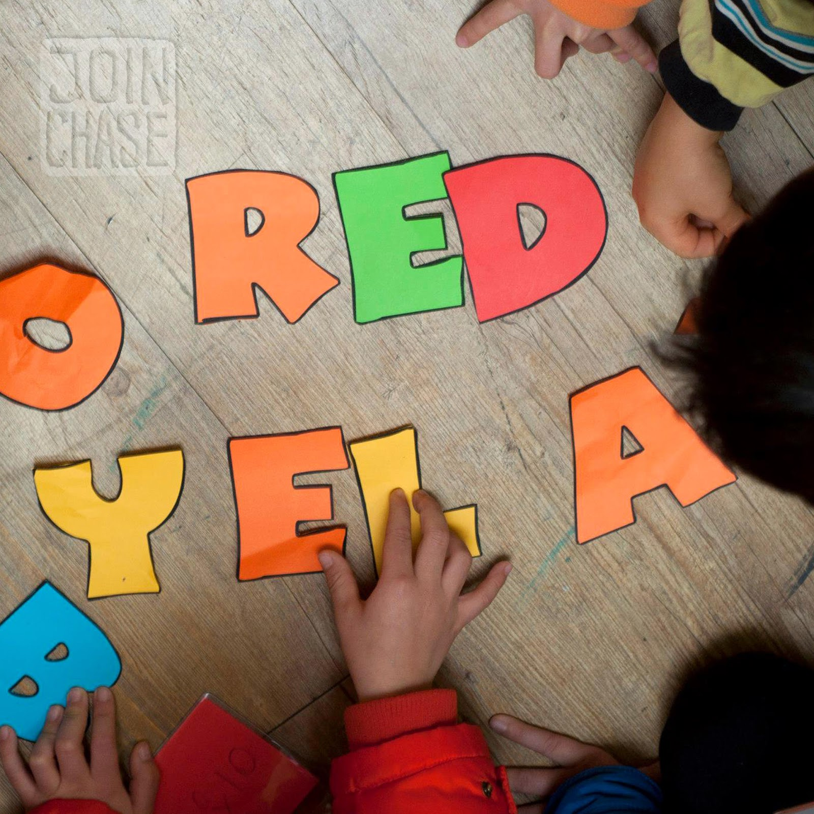 Students spelling English words during a game of Steal the Bacon in South Korea.