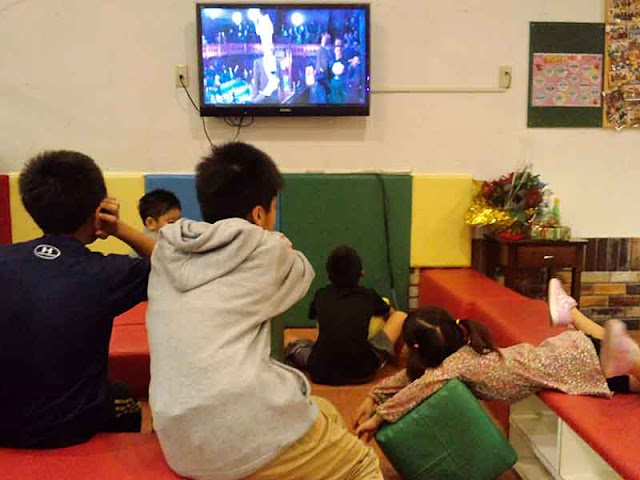 children,wide screen TV, movie, playing
