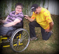 picture of caregiver tebowing behind wheelchair