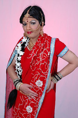 crossdressers 1 do you think that this girl in red saree with long