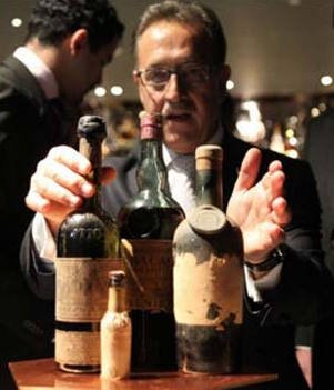 bartender salvatore calabrese with the bottles of drinks used for making the legacy cocktail