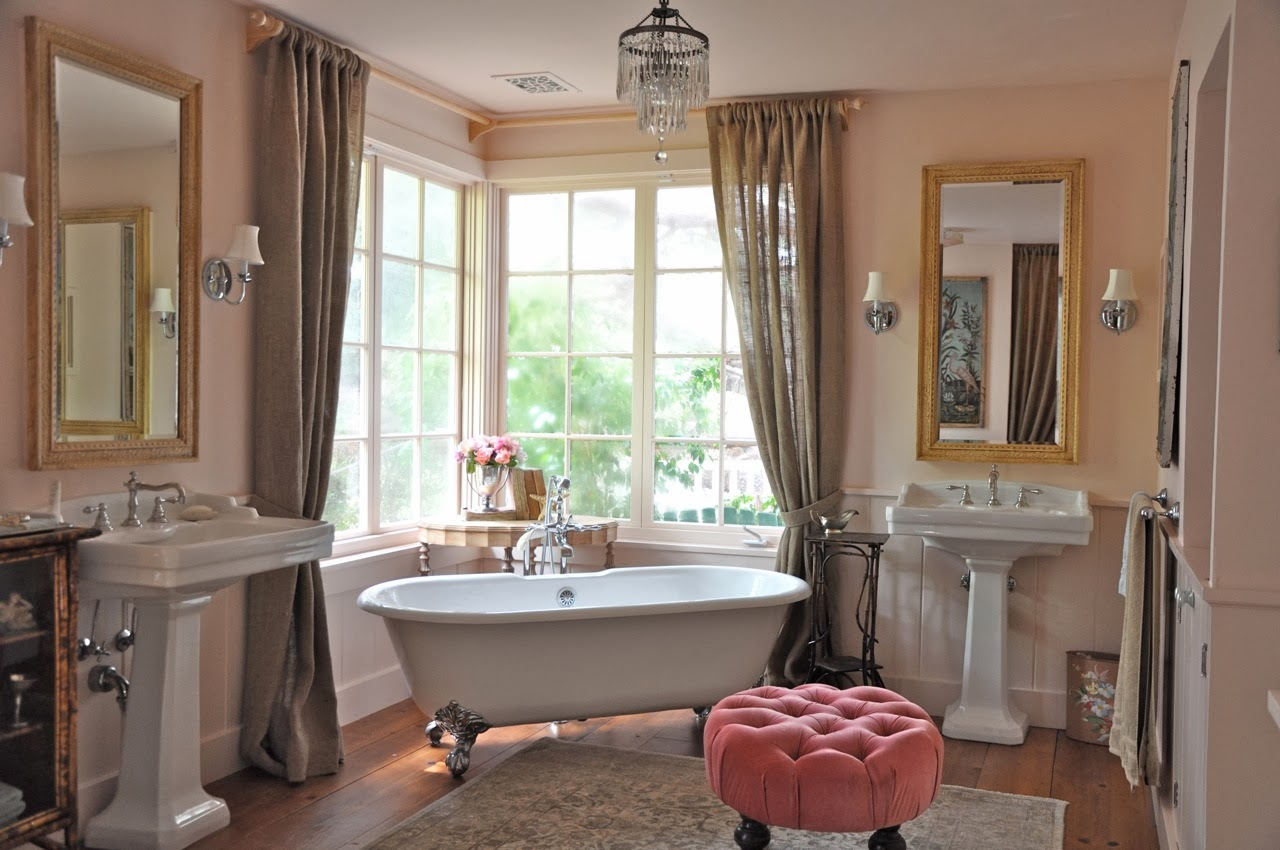 Elegant plush rugs and chairs in a Parisian style bathroom
