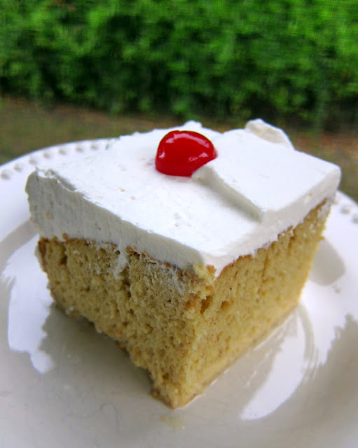 "Tres Leche Cake Recipe - delicious poke cake recipe - yellow cake mix, topped with sweetened condensed milk, evaporated milk and half and half - top the milk soaked cake with whipped cream and cherries! My husband took one bite and said ""This is dang good!"" - totally agree! Love at first bite!"