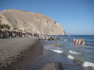The black sands of Perissa Beach in Santorini.