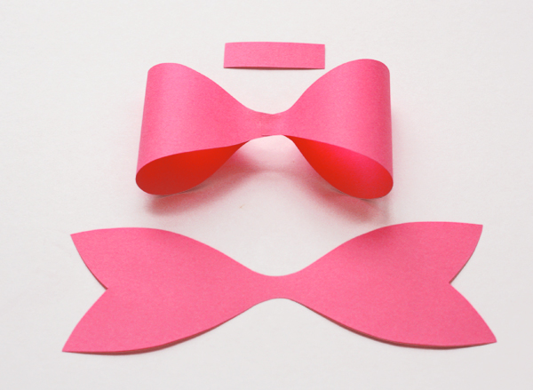 How to make a paper bow how about orange anyhow whether you wing it or use the template youll need three parts for each bow the band in the middle the loops and the tails maxwellsz
