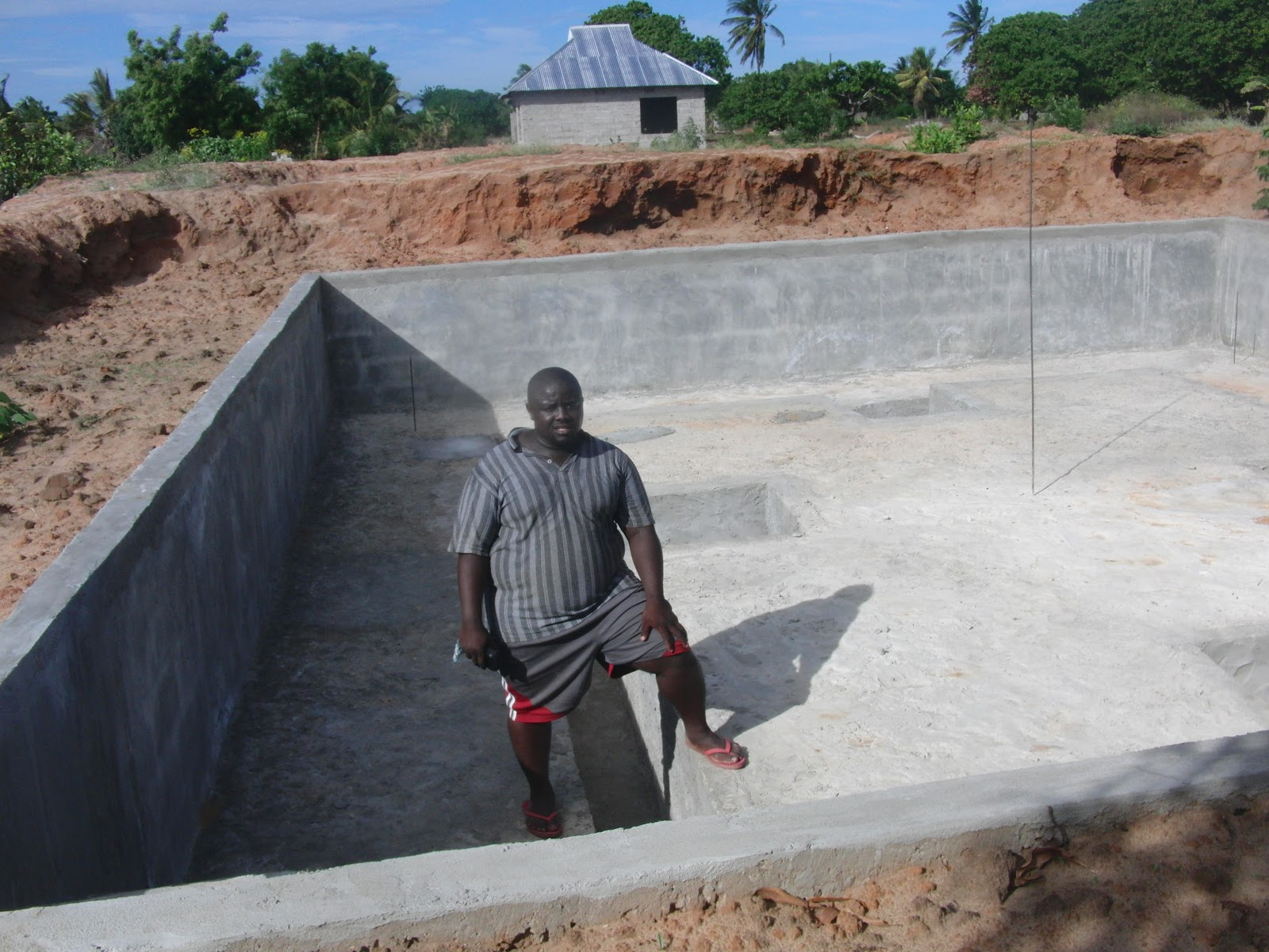 Amisodago consultancy firm concrete fish pond at mwongozo for Concrete pond construction
