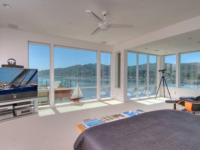 Photo of big modern bedroom with huge tv and the view