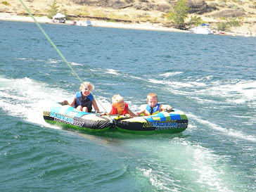 Sam(right), Keegan (middle), and I (left) on inner tube in 20101