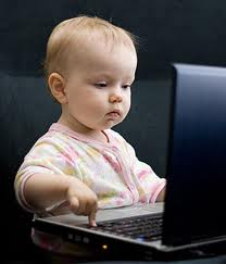 This is a baby on a laptop computer.