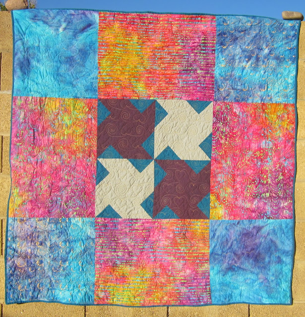 http://quiltparadigm.blogspot.com/2014/01/first-finish-of-2014.html