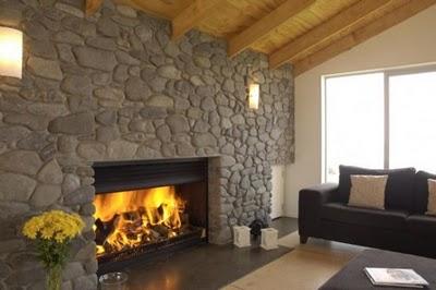 Calas decoraci n chimeneas recubiertas de piedra for Hogares modernos a gas