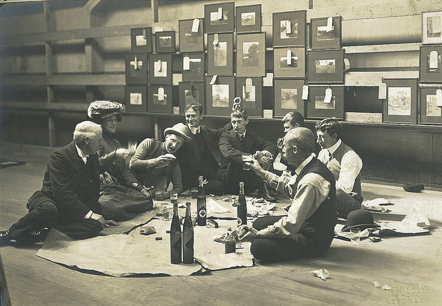 Society of Artists' Selection Committee, Sydney, 1907 / photographer Henry King. (l to r) Julian Ashton, Mrs Norman Lindsay, Harry Weston, Will Dyson, Norman Lindsay, young Souter, Sidney Long & D.H. Souter. Norman Lindsay is perhaps the best known of these young bohemian artists having a picnic in their rooms. He is looking pensive, fifth from the left.