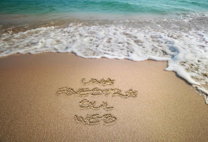 scritta-sulla-spiaggia