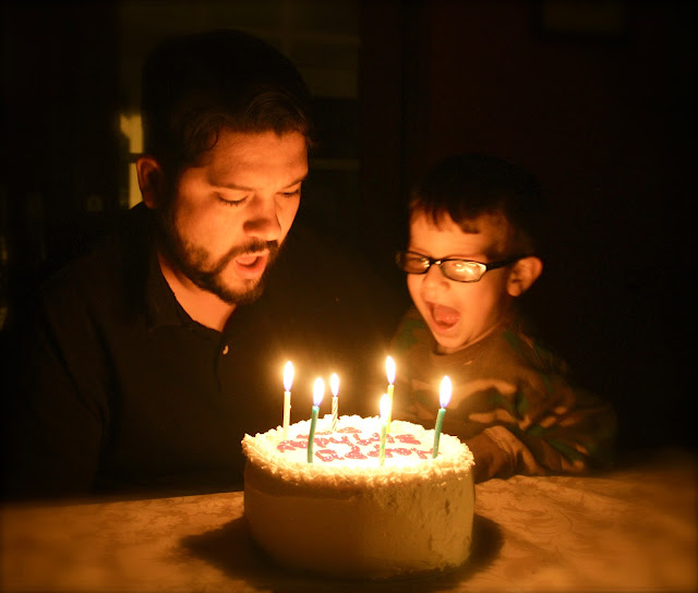 blowing out candles, candlelight - no flash