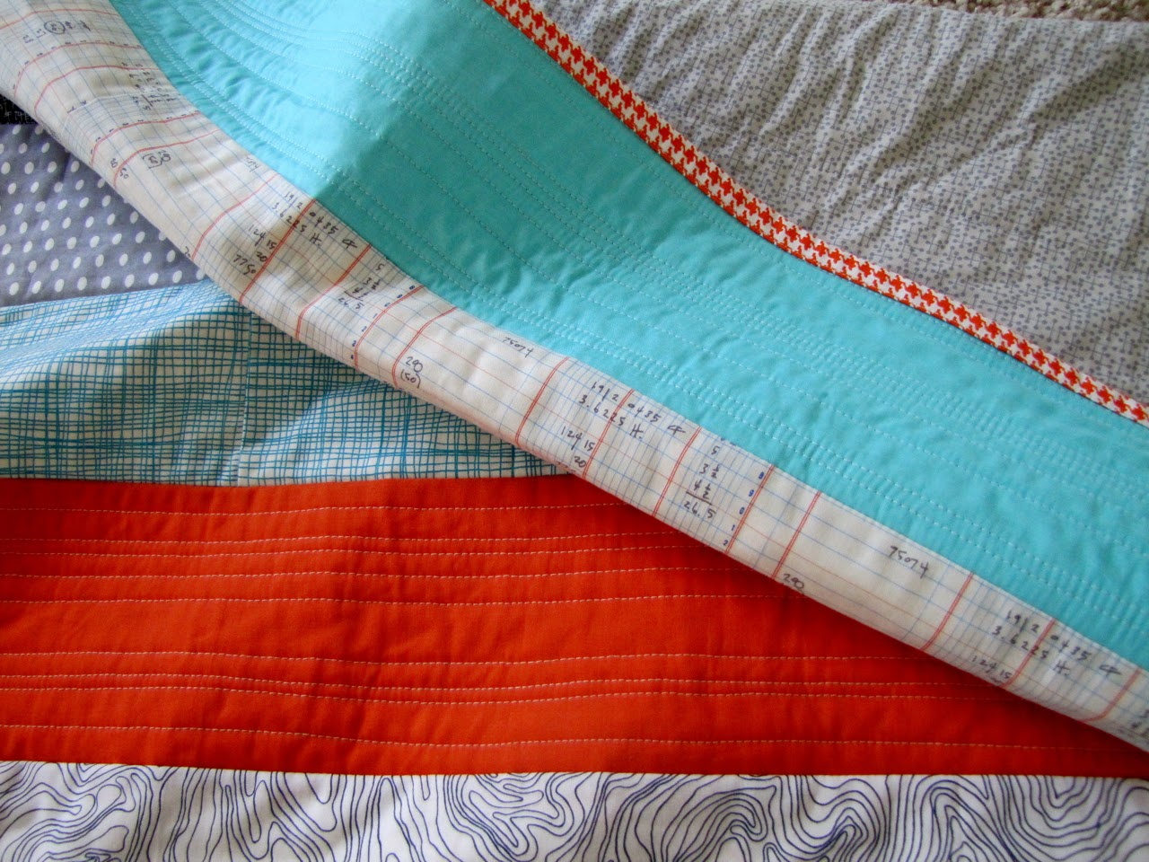 http://snippysisters.blogspot.com/2013/07/three-baby-quilt-finishes.html