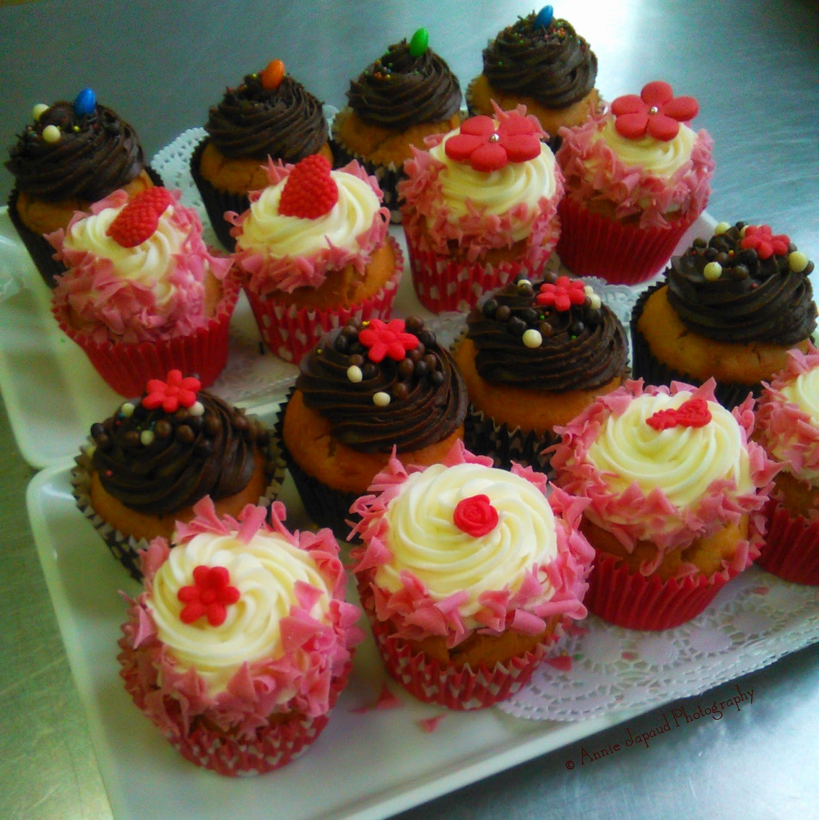 bunch of decorated cupcakes