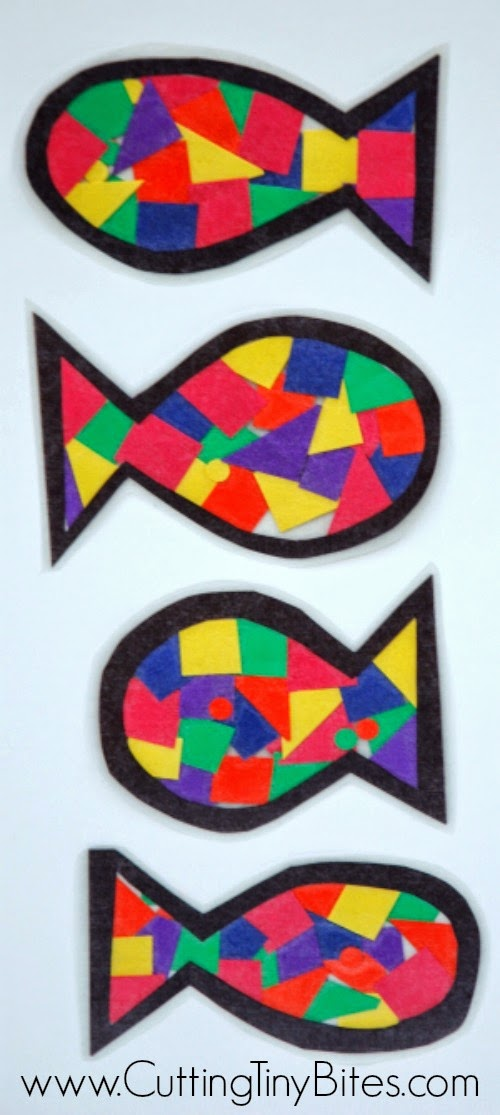 Rainbow fish kids craft, made with scraps of colored paper and contact paper. EASY, and perfect for a preschool ocean theme week.