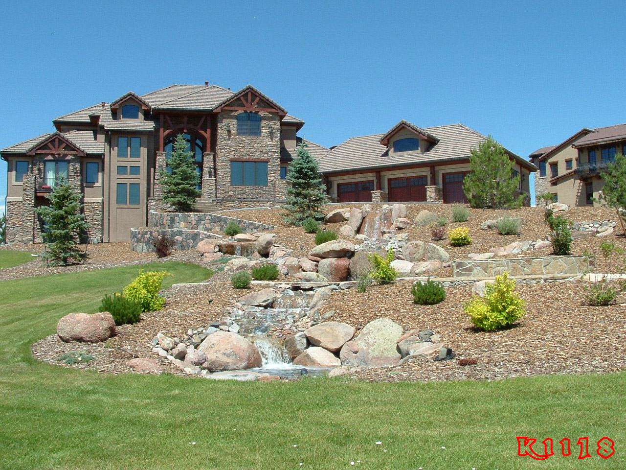 Here you go front lawn landscaping ideas side of hill for Rock garden designs front yard