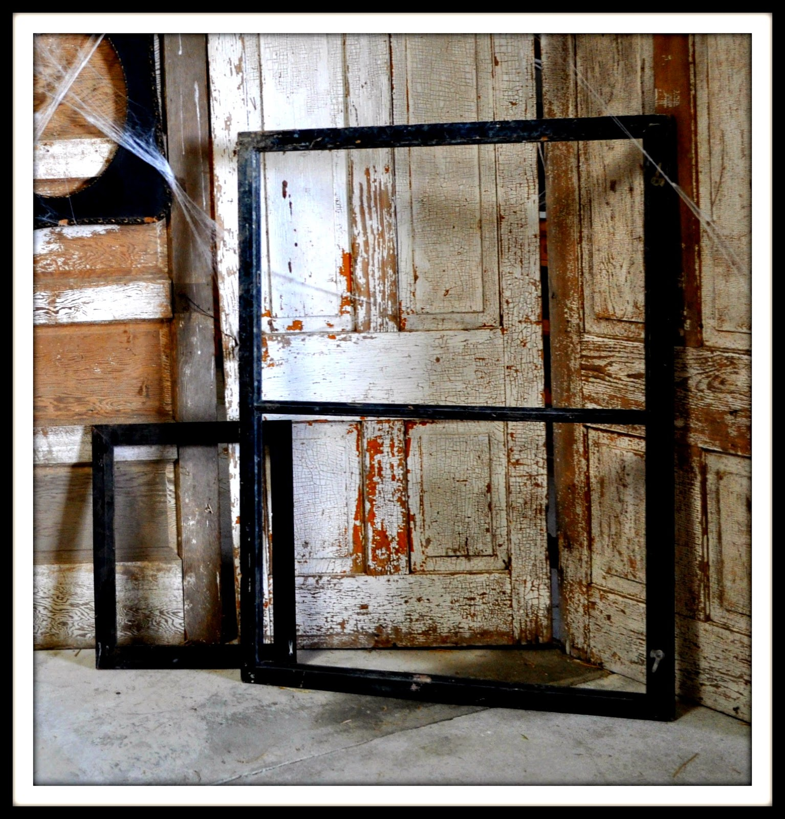 a large black wooden frame and an extra large old window frame were provided for people to pose behind if they wished but pictures looked good without the