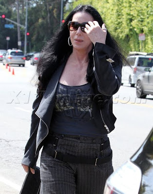 A close-up of Cher in a black jacket