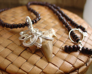 Completely feminine shark's tooth pendant in sterling wire by Vicky Brown of Shoredebris