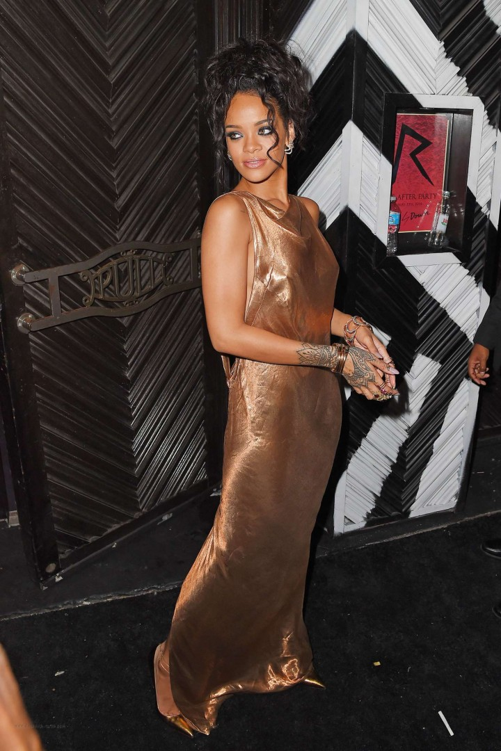 Rihanna in a low slung metallic dress at the 2014 Met Gala After Party