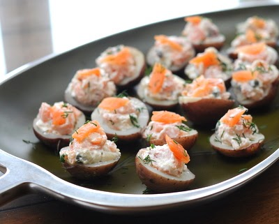 Potato Bites with Smoked Salmon, an easy appetizer with an elegant appearance, tiny potato halves stuffed with smoked salmon in a sour cream & horseradish sauce.