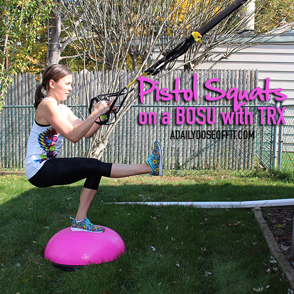 Pistol Squats on a BOSU with the TRX straps make for an awesome leg day challenge.
