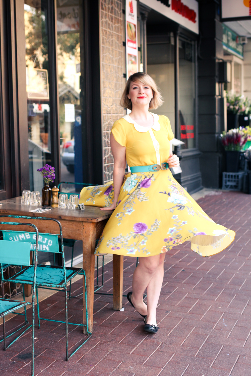 @findingfemme wears yellow Modcloth brand blouse with petal collar and Modcloth floral skirt during TPFF2015