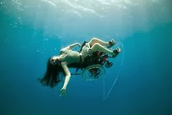 woman in wheelchair, underwater, with scuba gear