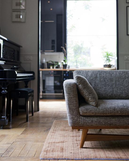 Masculine noir living room via The Socialite Family