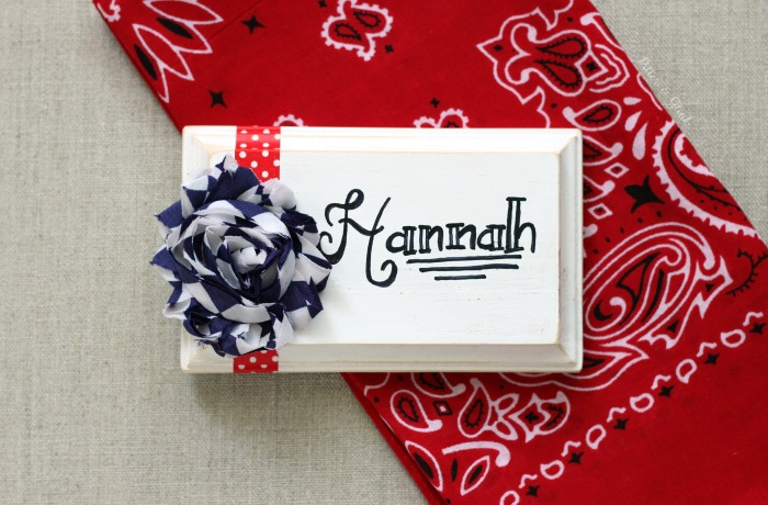 Use a small wooden plaque to create a personalized patriotic place card.  www.pitterandglink.com
