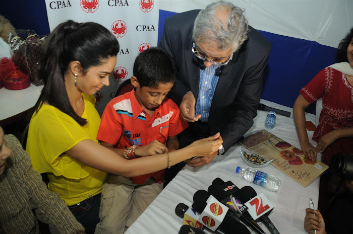 mallika sherawat visits cancer patients aid ociation. cute stills