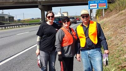 Volunteers from Fairway Independent Mortgage, picking up litter along Hwy 30.