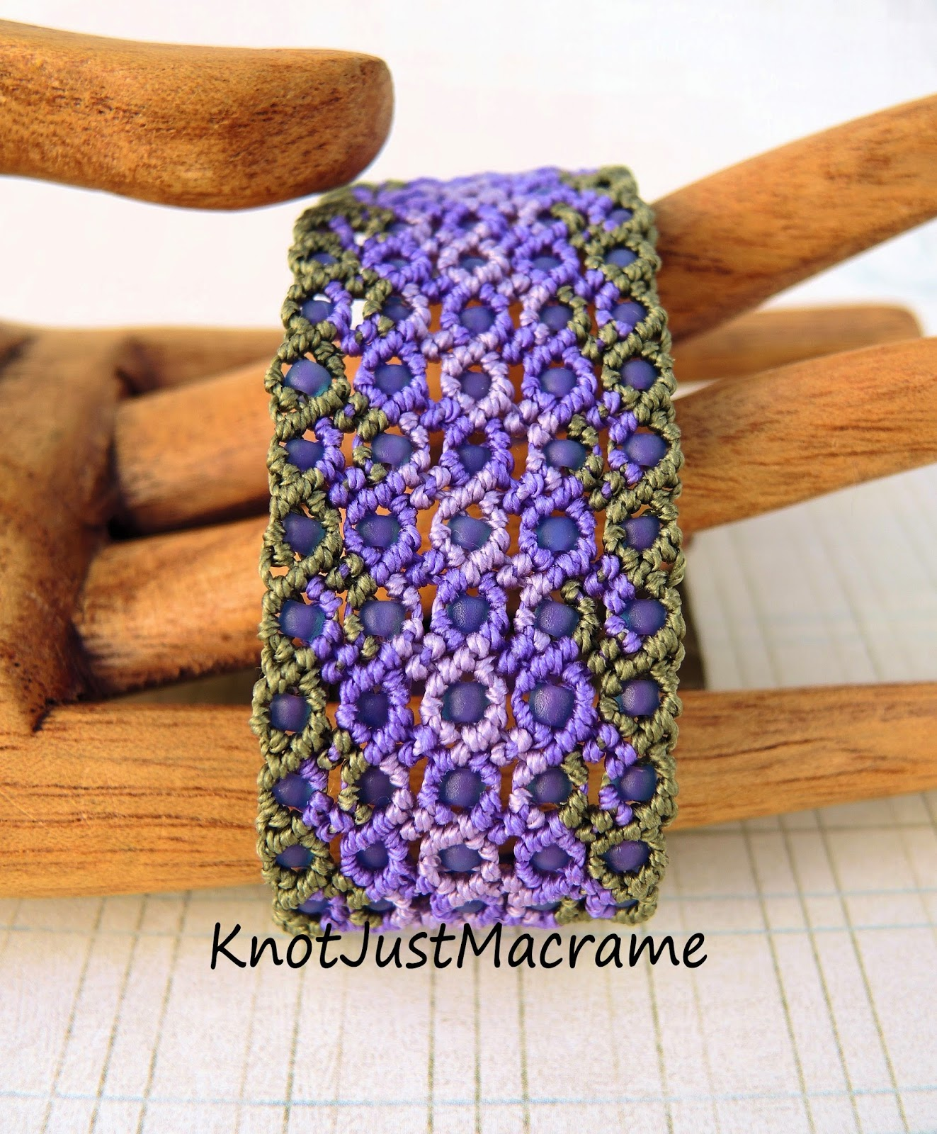 Knotted micro macrame bracelet in olive and purple.