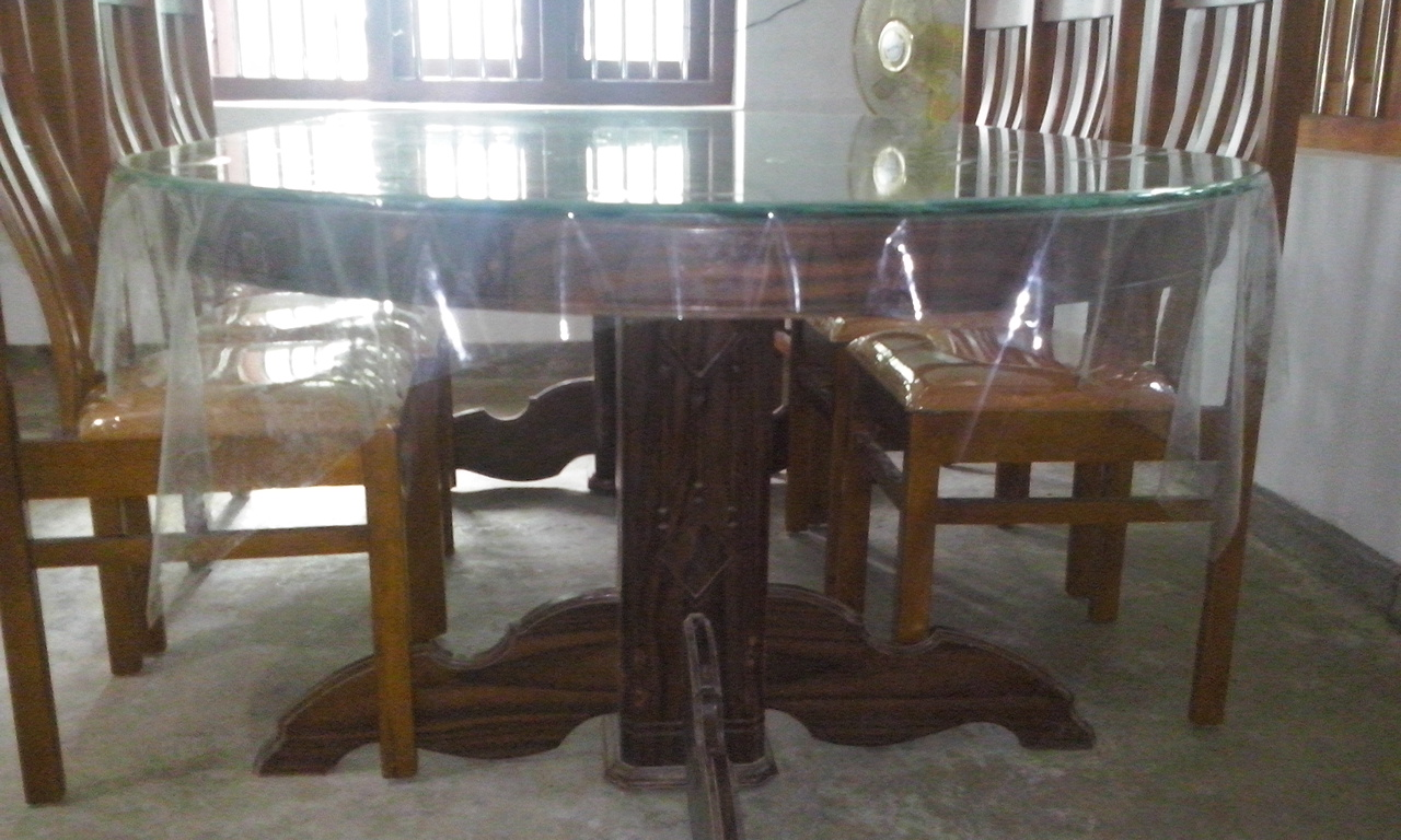 Kerala style carpenter works and designs wood dining for Design restaurant table