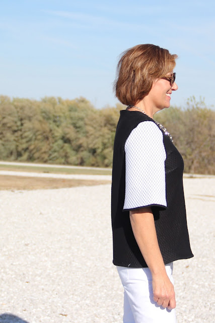 Mood Fabrics' quilted knit sewn into a boxy top, Butterick 6175