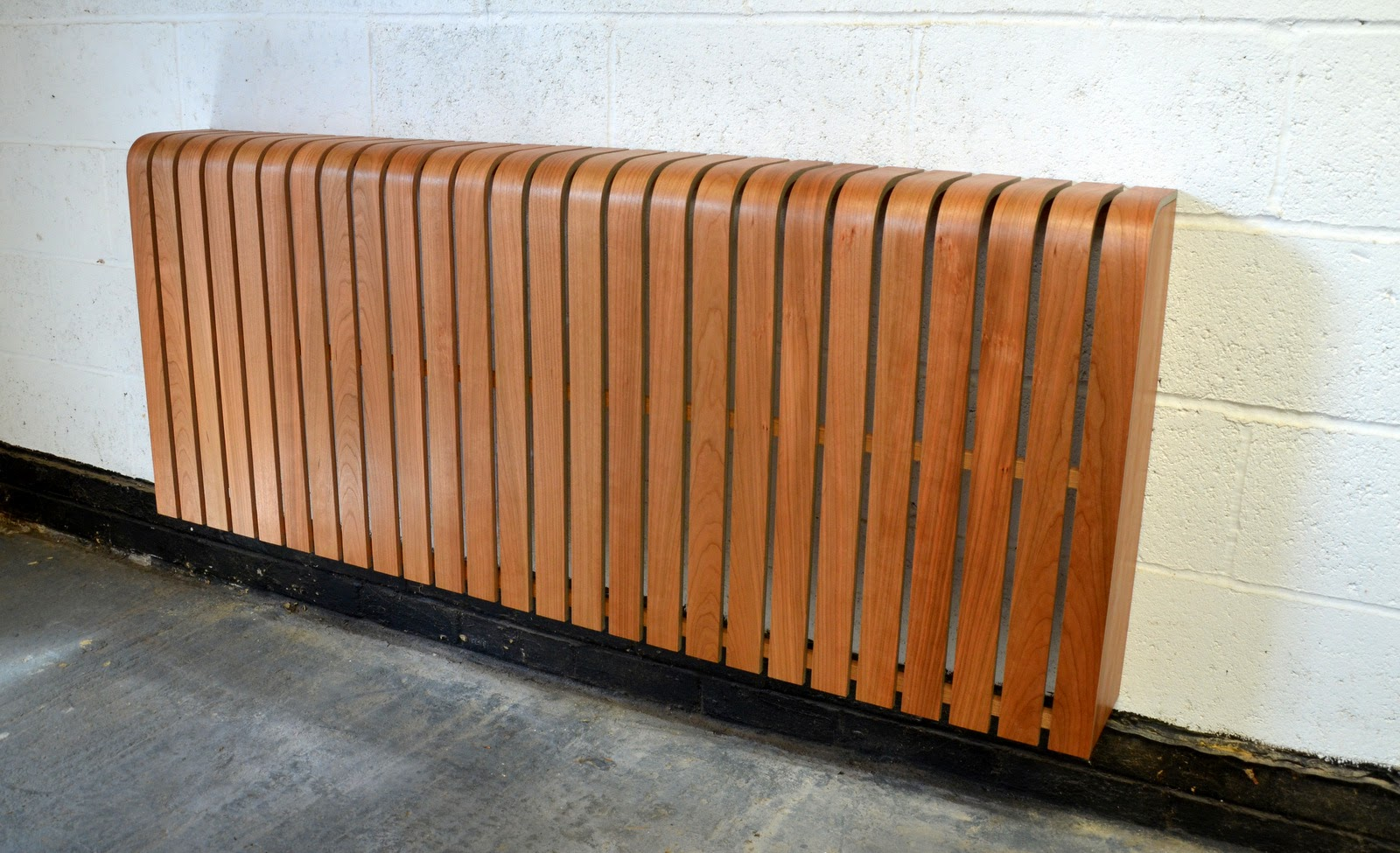 Modern radiator cover in american cherry timber