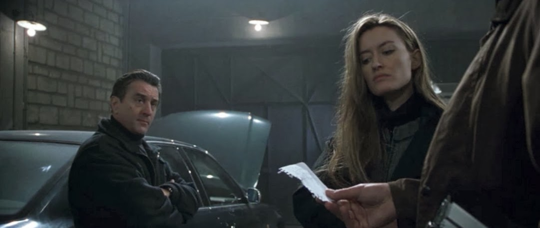 Natascha McElhone as the enigmatic and icy Irish lass Deirdre. Ronin, 1998. screenshot, sweater and overcoat costume design - May Routh